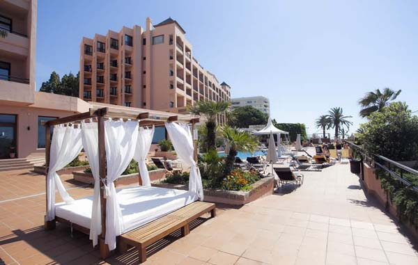 Fuerte Hotel Marbella outdoor pool and sunbeds area